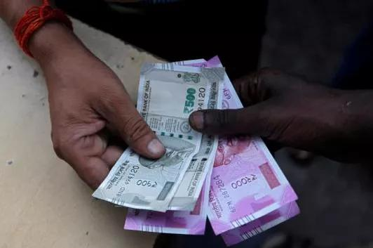 Rupee Tanks 95 Paise to 76.15 Against US Dollar as Coronavirus Cases in India Rise