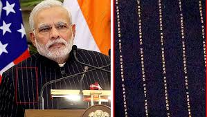 Modi's famed monogrammed pinstripe suit will be auctioned