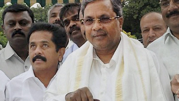 CM Siddarmaiah on table with State Budget Today.